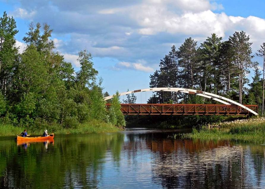 Mesabi Trail Bridge with canoe Paul Pluskwik